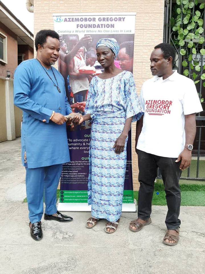 Mrs Afolayan, a Widowe receives N20,000 cash to support the education of her 2 kids, Dare and Michael